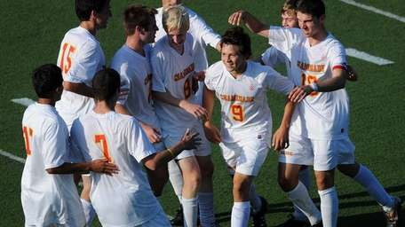 Chaminade's Nicholas Joesten gets congratulated by teammates after