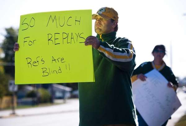 Green Bay Packers fan Mike LePak holds a