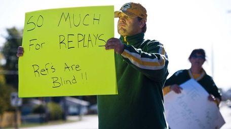 Green Bay Packers fan Mike LePak holds a
