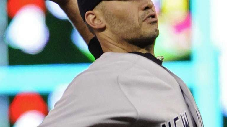 Andy Pettitte delivers a pitch to a batter