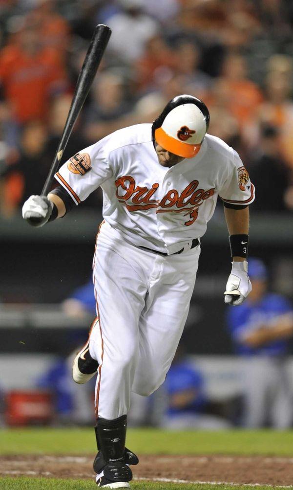 The Baltimore Orioles' Ryan Flaherty slams his bat