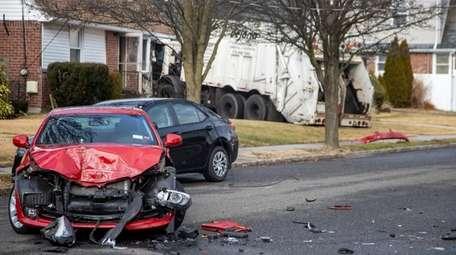 A garbage truck destroyed a car and seriously