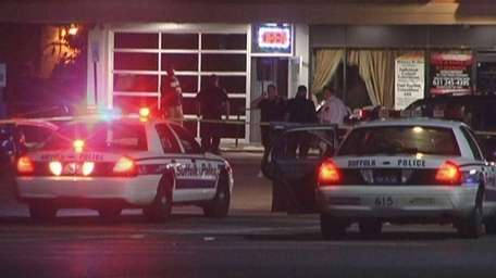 Suffolk County police investigate a fatal stabbing on