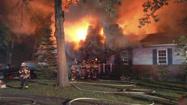A late-night fire destroyed a house in Centereach,