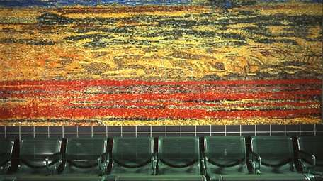 This mosaic by Roy Nicholson was installed at