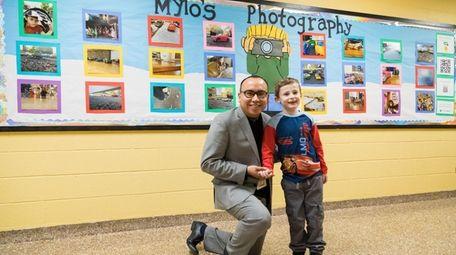 Mylo Trinagel with his art teacher, Jesus Modesto,