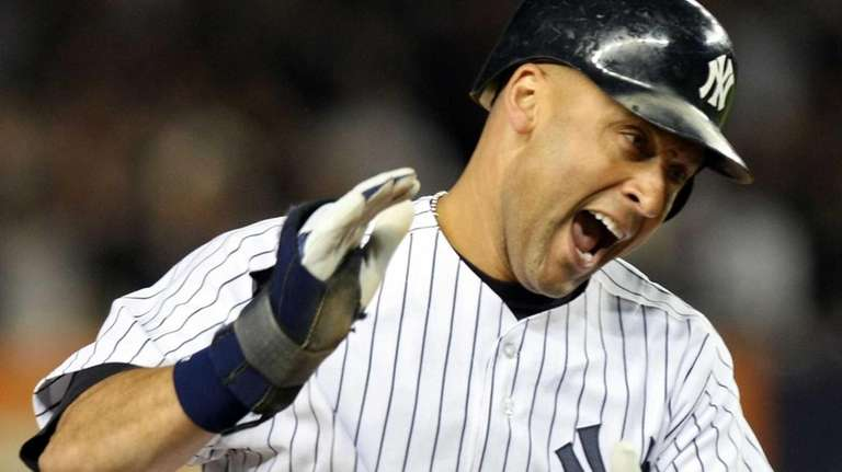 Derek Jeter celebrates after being brought home to