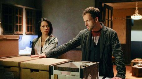 Sherlock (Jonny Lee Miller) and Joan (Lucy Liu)