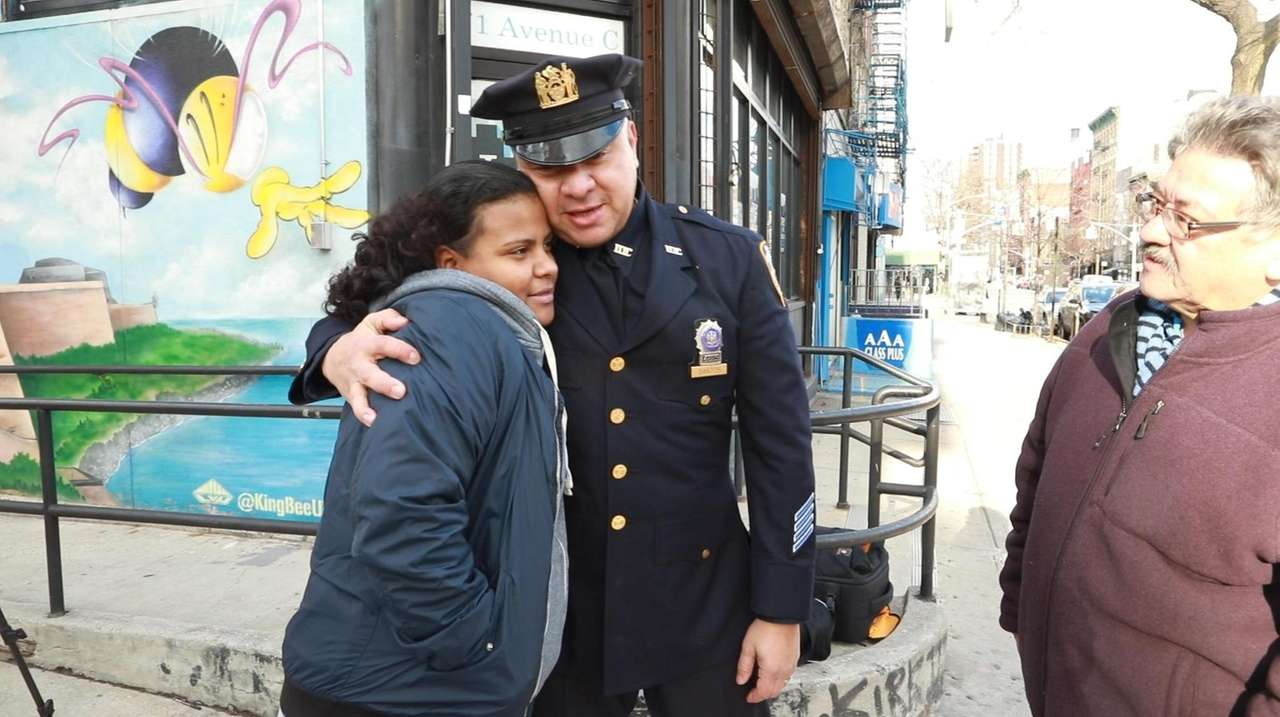 Det. Carlos Santos saved a choking, 5-year-old Sofhia