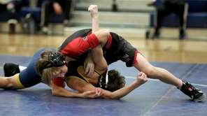 Mt. Sinai's Brayden Farbach looks to pin Shoreham's