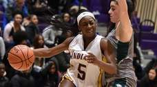 Samirah Akinwunmi #5 of Sewanhaka, left, gets pressured