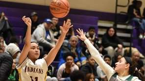 Angelica Lazo #11 of Sewanhaka, left, shoots a