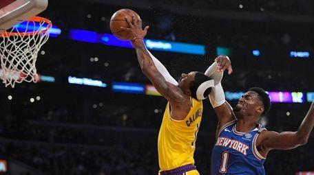 Knicks forward Bobby Portis, right, fouls Los Angeles