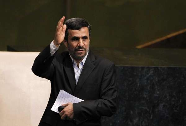 Mahmoud Ahmadinejad, president of Iran, gestures after addressing