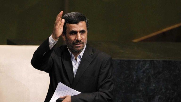 Mahmoud Ahmadinejad, president of Iran, gestures after addressing