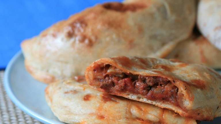 Hearty calzones are stuffed with lean ground beef,