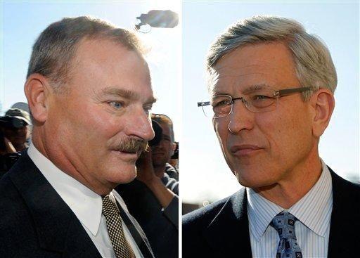 Former Penn State vice president Gary Schultz, left,