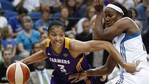 Los Angeles Sparks forward Candace Parker, left, drives