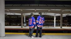 Teens wait on the platform at the Hicksville