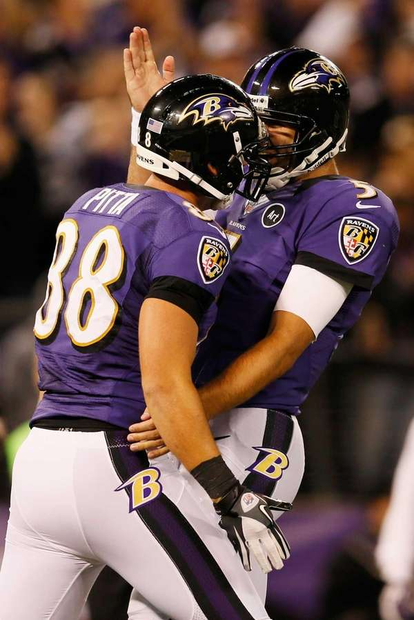 Dennis Pitta and Joe Flacco celebrate after they
