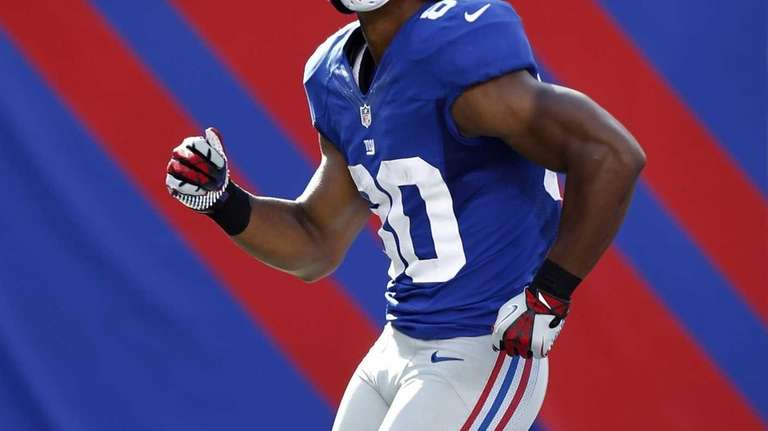 Victor Cruz celebrates a touchdown with his signature