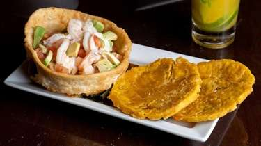 Shrimp ceviche arrives with avocado, sour orange, tomato,