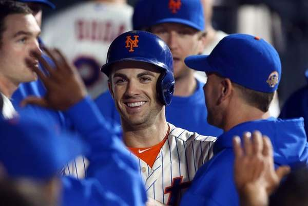 David Wright celebrates after scoring in the fourth