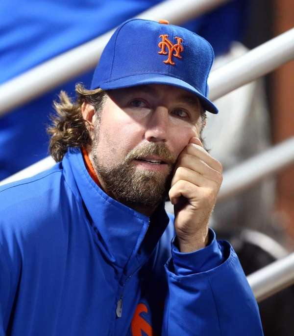 R.A. Dickey looks on from the dugout during