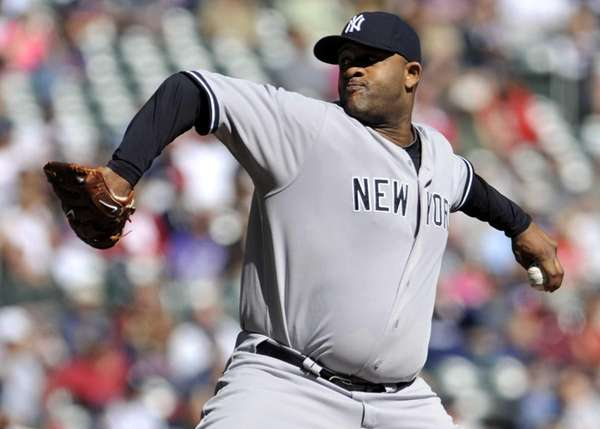 CC Sabathia delivers a pitch during a game
