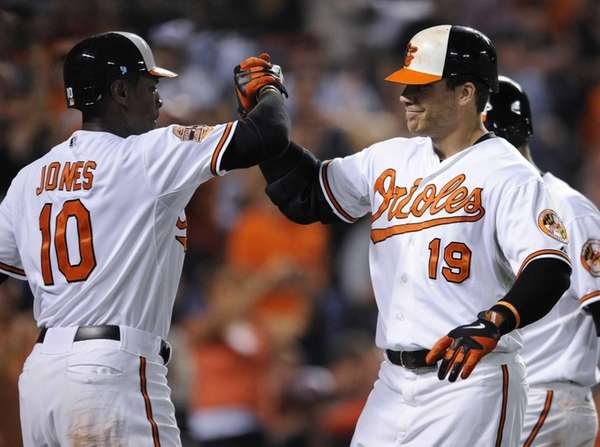 Baltimore Orioles' Chris Davis celebrates with Adam Jones