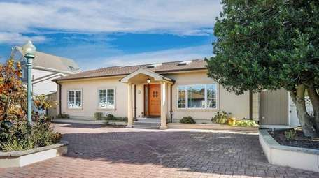 Priced at $879,000, this 1,684-square-foot canal-front expanded ranch