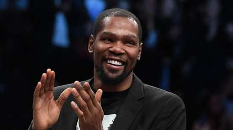 Nets' Kevin Durant reacts during the second half