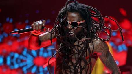 Rapper Lil' Wayne performs onstage during the 2012