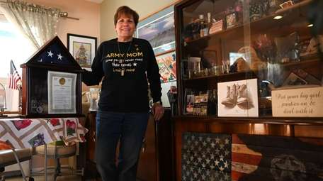 Lisa Ryan, at her Hicksville home, finds comfort
