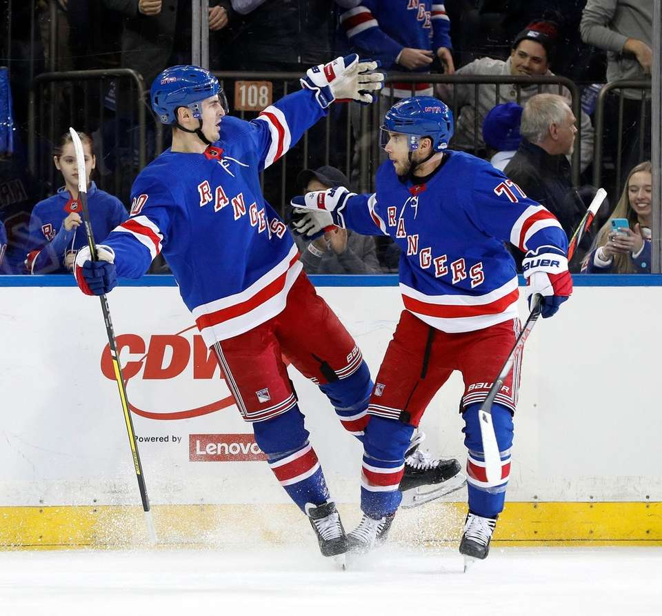 Chris Kreider, left, of the Rangers celebrates his