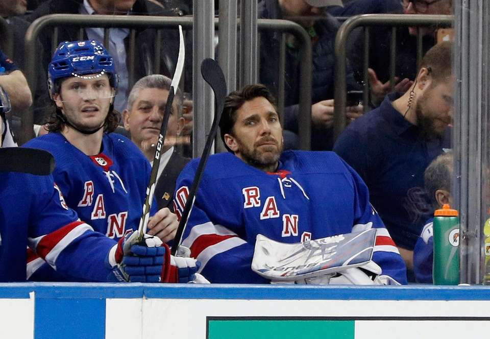 Henrik Lundqvist #30 and Jacob Trouba #8 of