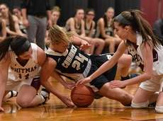 Claire Janis #24 of Commack, center, tries to