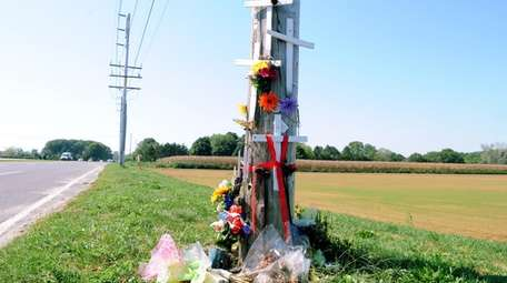 Makeshift memorial at the intersection of County Road