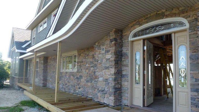 Islip architect James Bouler designed this faux-stone facade