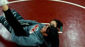 Girls wrestling coach Amber Atkins wrestled more than