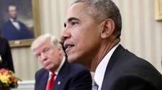 President-elect Donald Trump listens as President Barack