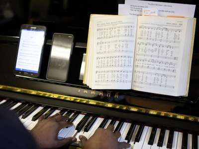 Pianist Bernard Corbett accompanies the Church-in-the-Garden choir during