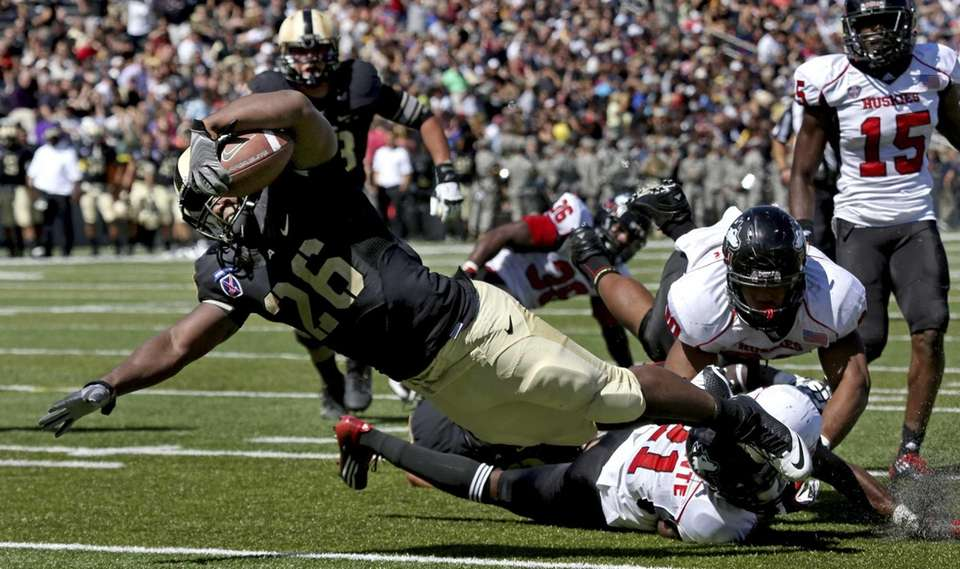 Army's Larry Dixon dives past opponents from Northern