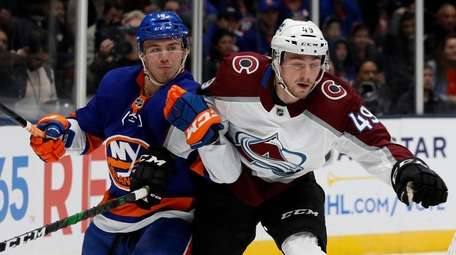 Anthony Beauvillier of the Islanders and Samuel Girard