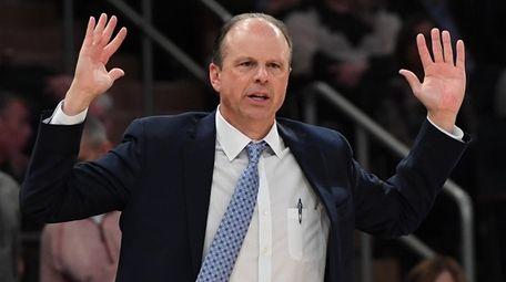 Knicks interim head coach Mike Miller gestures during