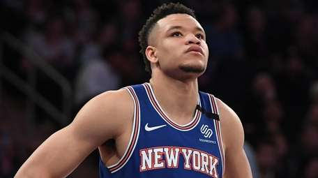 Knicks forward Kevin Knox II looks on during