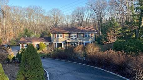 This Dix Hills house is on a private