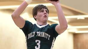 TJ Long of Holy Trinity shoots a jumper
