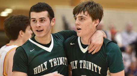 Mike Sixsmith of Holy Trinity, left, and TJ