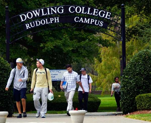 Students walk through the Dowling College campus in